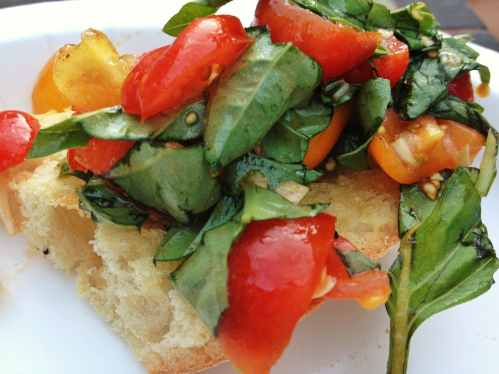 This Tomato & Basil Salad is great on toasted garlic bread or with chicken or shrimp!
